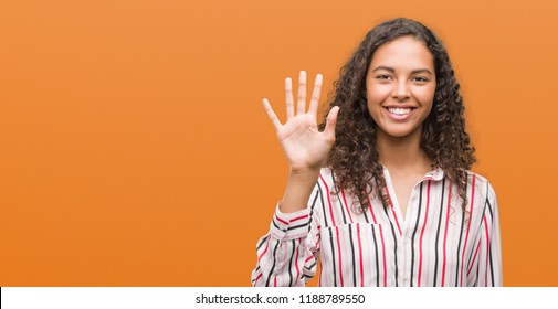 Beautiful young hispanic woman showing and pointing up with fingers number five while smiling confident and happy.