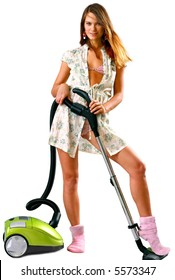 Beautiful and young housewife with green vacuum cleaner over white background - looking at camera