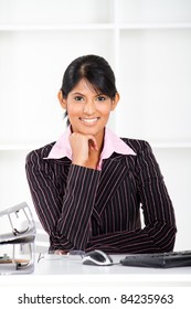 beautiful young indian businesswoman in office
