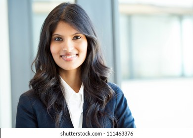 beautiful young indian businesswoman portrait in office