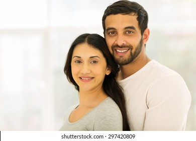 beautiful young indian couple looking at the camera