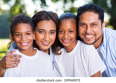 beautiful young indian family portrait outdoors