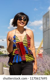 Beautiful young Indian woman posing in an urban context. Street fashion and style.