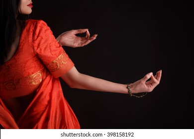 ff72d0c761 Beautiful Young Indian Woman in red Traditional Clothing with perfect Makeup  and Oriental Jewelry. Beautiful