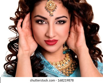 Beautiful young indian woman in traditional clothing with bridal makeup and jewelry. gorgeous brunette bride. Girl bollywood dancer in Sari. Arabian bellydancer