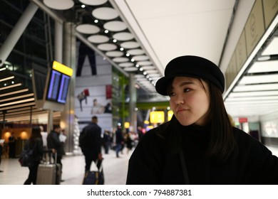 A beautiful young Japanese woman waiting in the airport