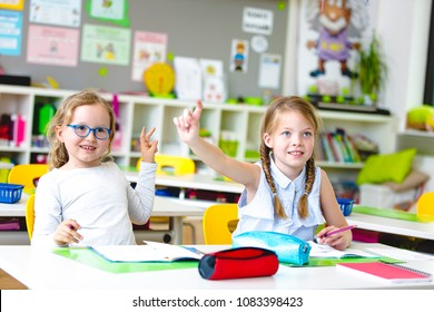 Beautiful young kids have fun in school while learning in classroom