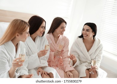 Beautiful young ladies with champagne at pamper party. Women's Day