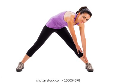 Beautiful young lady doing her every day fitness workout - isolated background.