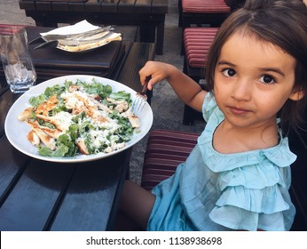 Beautiful young lady eating salat Cesar