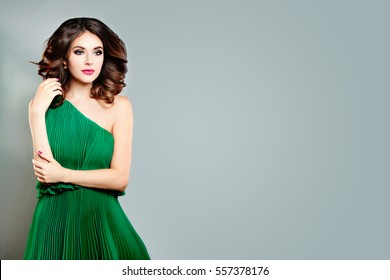 Beautiful Young Lady Fashion Model. Perfect Woman in Green Dress on Gray Banner Background with Copy space
