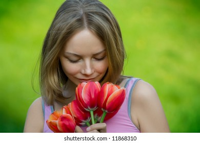 beautiful young lady with flowers outdoor smiling
