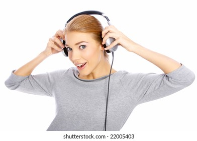 Beautiful young lady is listen to the music, isolated
