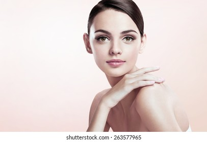 Beautiful young lady with make up face on beige background