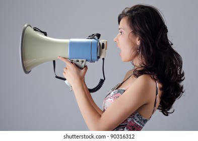 Beautiful young lady posing with a speaking-tube