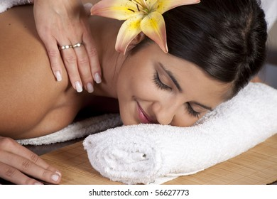 Beautiful young lady in spa salon