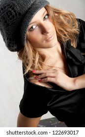 Beautiful young lady wearing winter clothing studio session