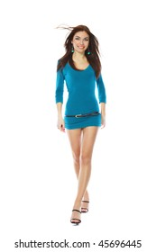 Beautiful young leggy brunette in a little blue cocktail dress full height