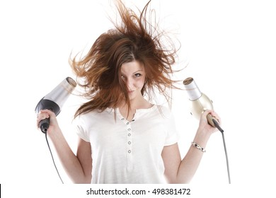 Beautiful young long haired beautiful woman drying hair with hairdryer