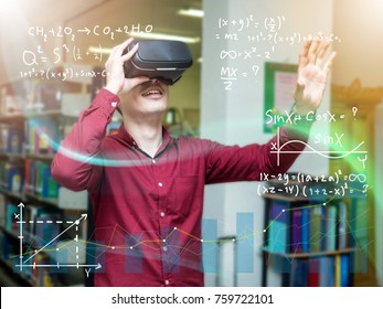 A beautiful young man in a library travels in a virtual futuristic world with augmented reality. Concept: educational, future, library, and immersive technology.