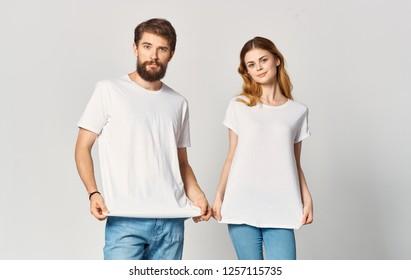 Beautiful young men stretch the shirt
