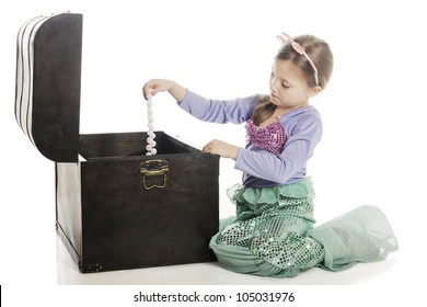 A beautiful young mermaid pulling a strand of large pearls from an old treasure chest.  On a white background.