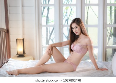 beautiful young model asian nude posed sexy in underwear on the white bedroom