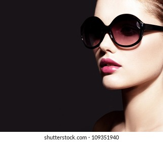 Beautiful young model with big glasses-close up