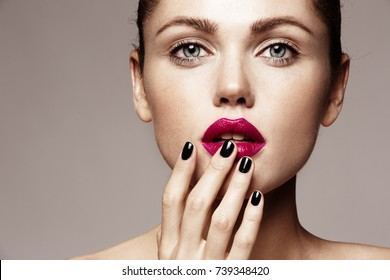 Beautiful young model with bright make-up and manicure