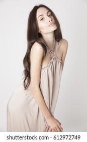 beautiful young model in elegant dress. Fashion photography.Studio shot, Vertical.