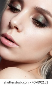 beautiful young model with evening make up, perfect skin. Trendy smoky eyes