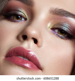 beautiful  young model with evening professional make up, perfect skin. Trendy colorful smoky eyes