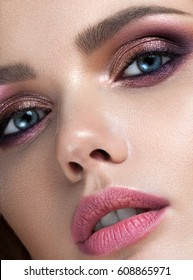 beautiful  young model with evening professional make up, perfect skin. Trendy pink smoky eyes