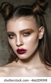 Beautiful young model with fashion makeup. Red lips. Bright make up. Trendy hairdo