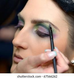 beautiful young model getting fashion make-up