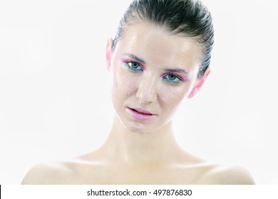 Beautiful young model with long wet hair, light makeup, fresh summer look with damp beach hairstyle
