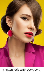 beautiful young model with pink lips and healthy skin on bright background. Trendy summer makeup. Retro style