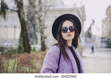 beautiful young model posing on the street