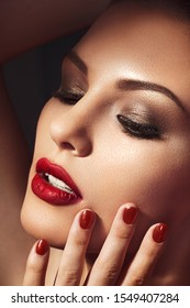 Beautiful young model with red lips. Gorgeous Woman Face. Bright makeup.