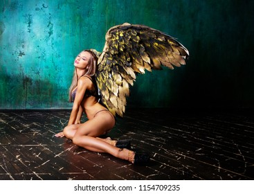beautiful young model wearing  angel wings in the studio