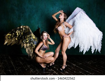 beautiful young models wearing  angel wings in the studio