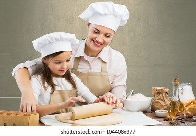 Beautiful young mom and child cooking