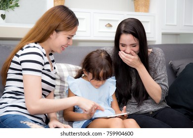 beautiful young mother, aunt and kid having time together with smile and happy learning on digital tablet in the living room at home, family activity concept.