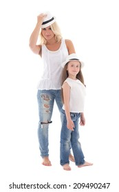 beautiful young mother and little daughter posing with hats isolated on white background