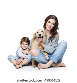 Beautiful young mother with little daughter and dog