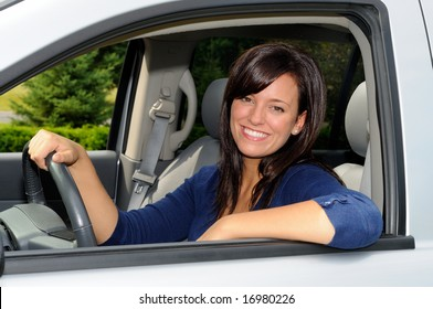 Beautiful Young Mother At The Wheel Of Her Sport Utility Vehicle