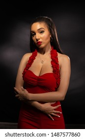 Beautiful young multiracial woman in a tight red dress