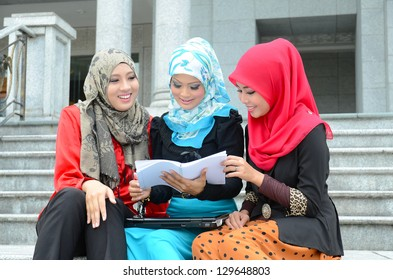 beautiful young muslim businesswoman sharing info together