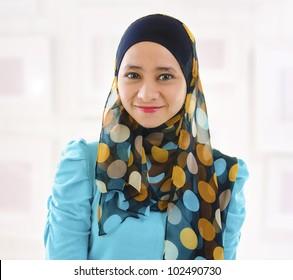 Beautiful Young Muslim girl smiling, indoor.