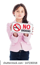 A beautiful young nine year old girl holding a no smoking sign. Isolated on a studio white background. A warning and an instruction.